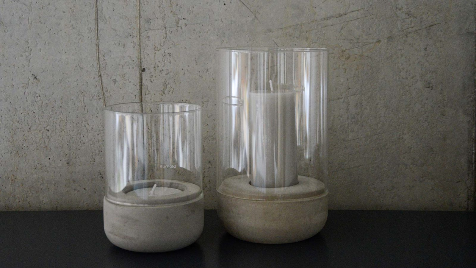 minimalist candle holders with concrete bases