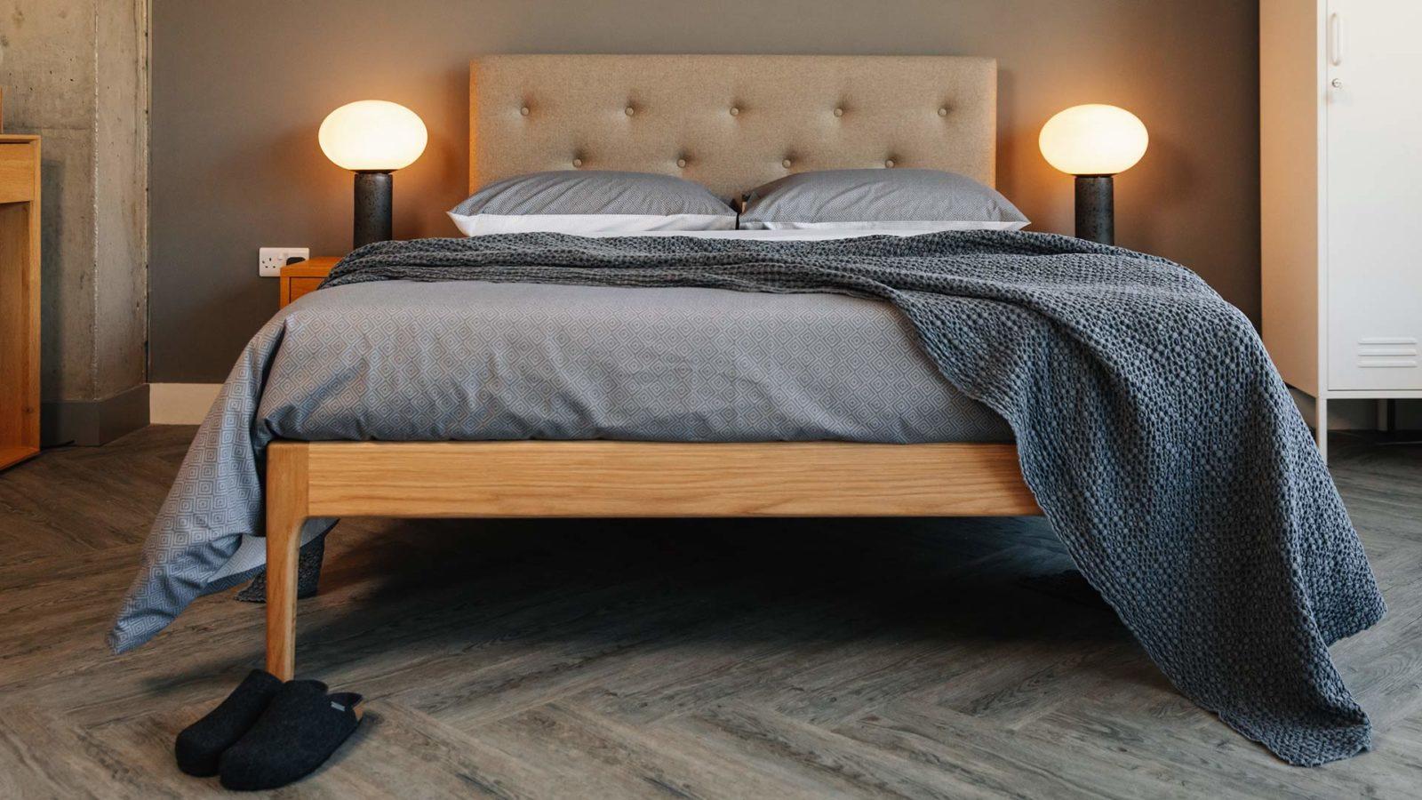 Scandinavian bedroom look - grey bedding on midcentury style Bloomsbury bed