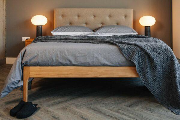 Scandinavian bedroom look grey bedding on midcentury style Bloomsbury bed