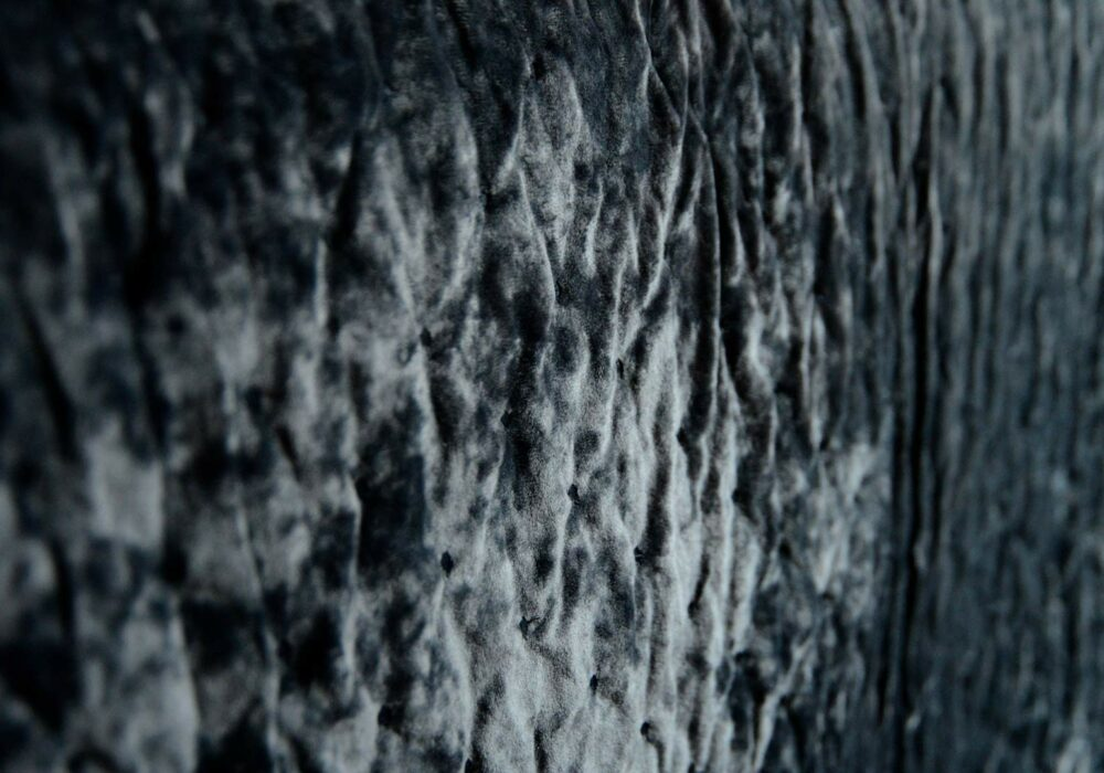 a closer view of our luxury crushed velvet bedspread in inky slate grey