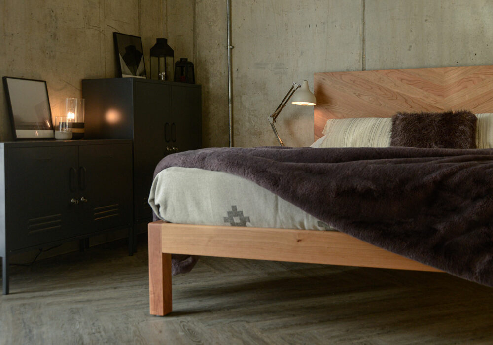 low level view of the Hathersage handmade solid wood bed with chevron headboard
