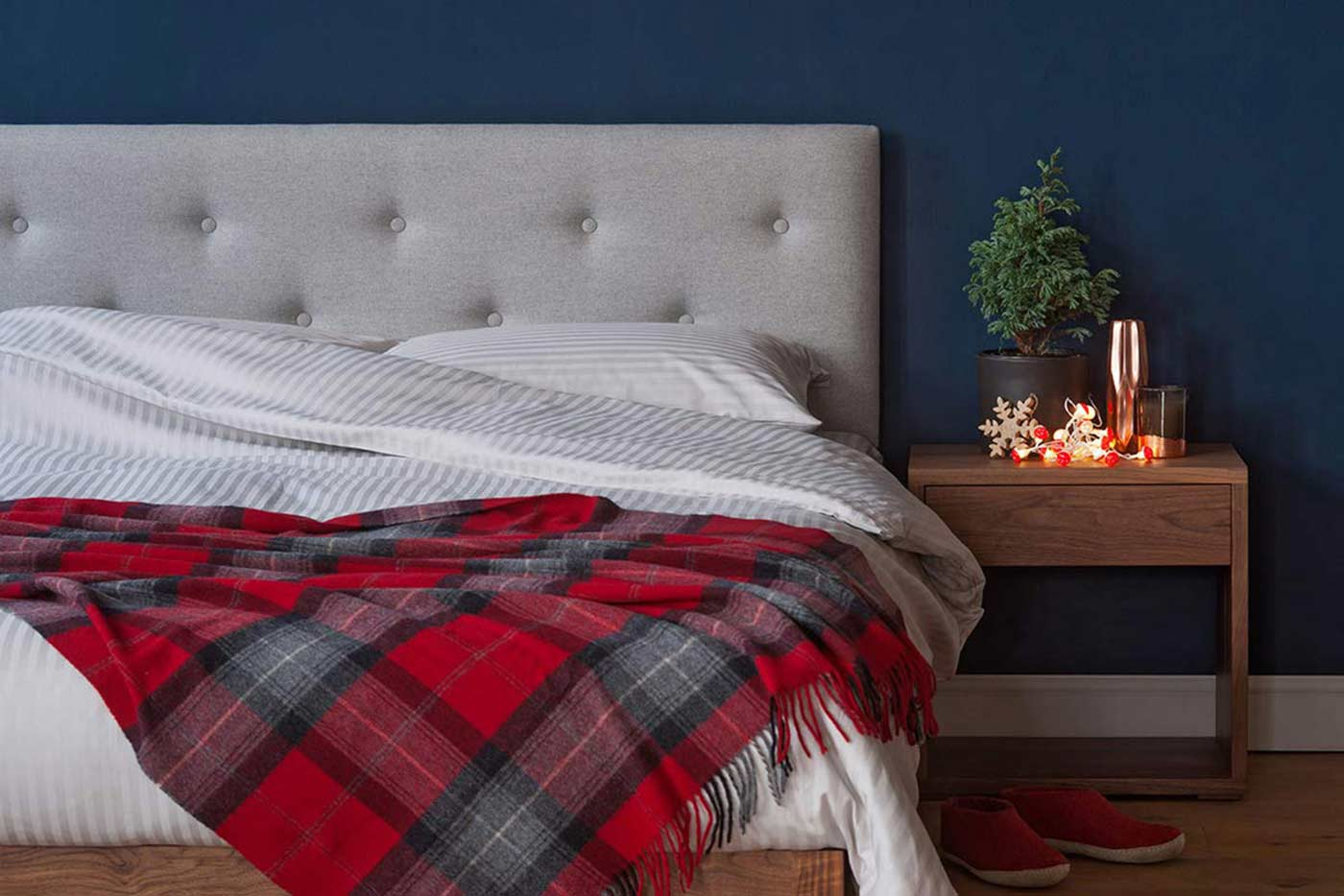 cosy christmas bedroom - featuring upholstered Arran bed & Cube table in Walnut