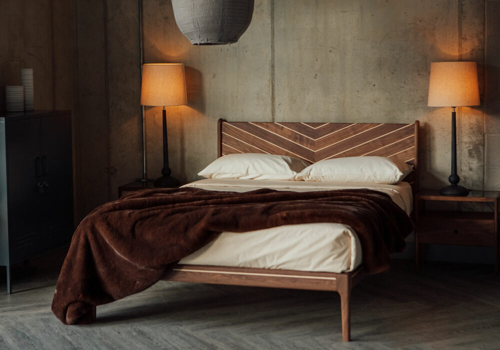Classic bedroom style featuring a handcrafted solid wood bed in walnut and maple with Chevron design to the headboard