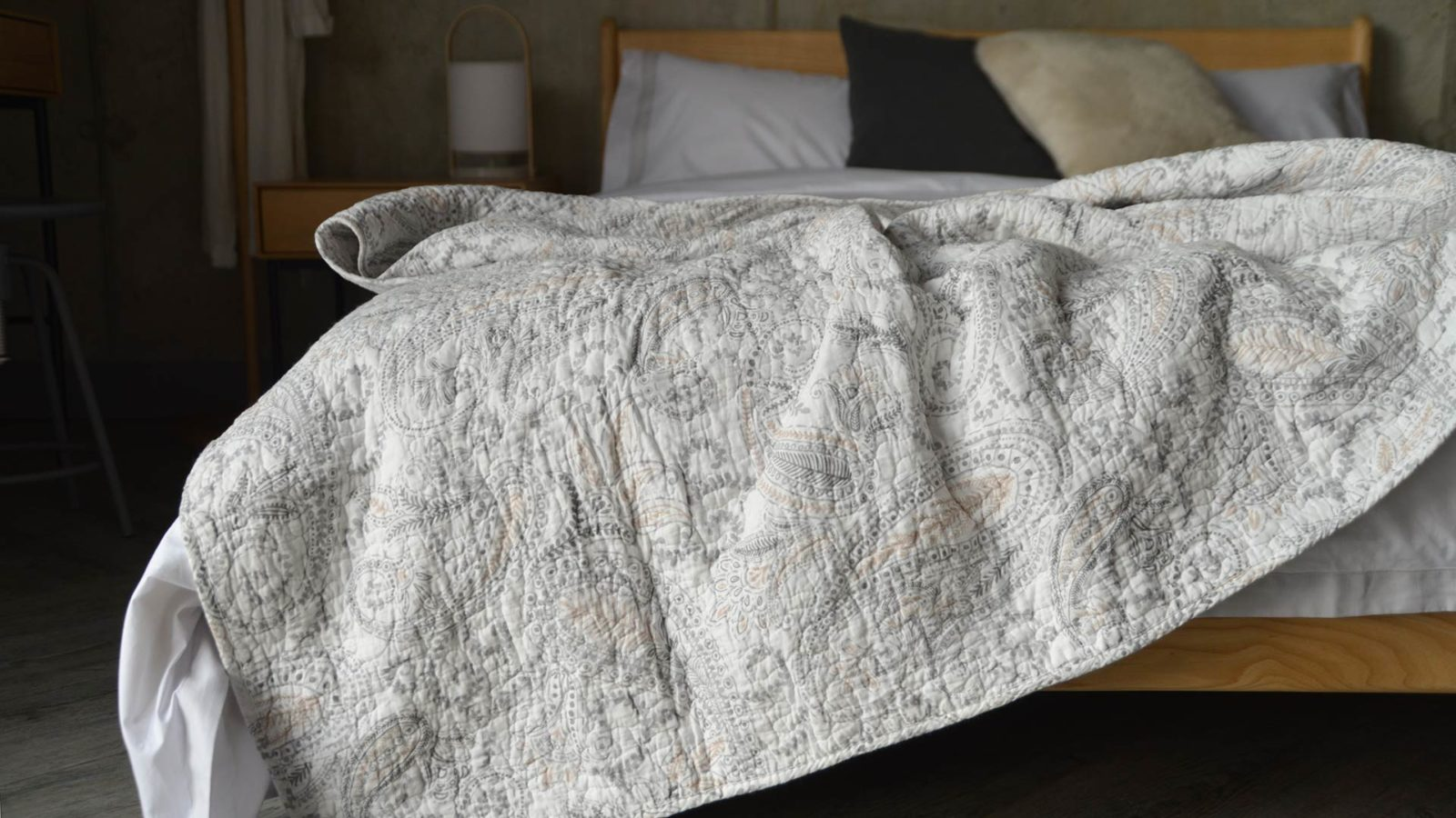 white and grey patterned throw
