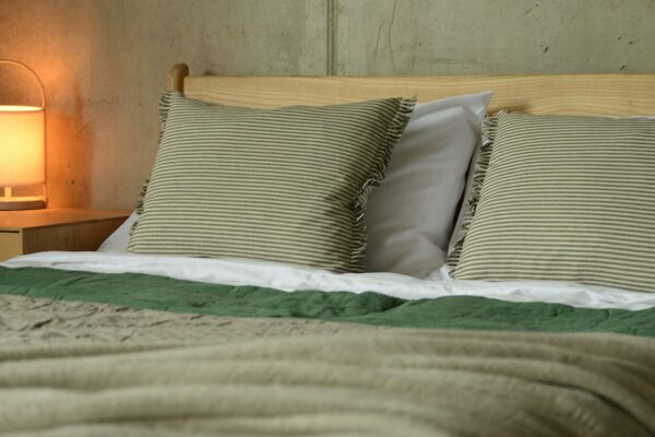 green and cream stripe cushions made with recycled cotton