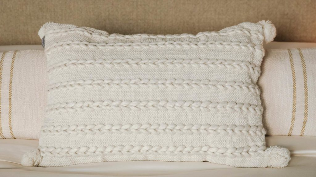 cream cushion with woven stripe