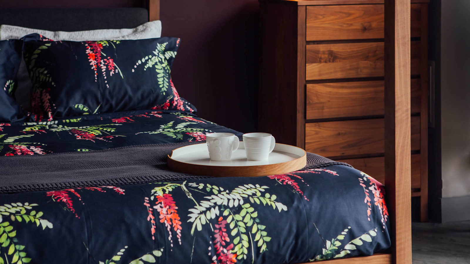 Printed floral duvet set on our hand crafted walnut Highland 4 poster bed