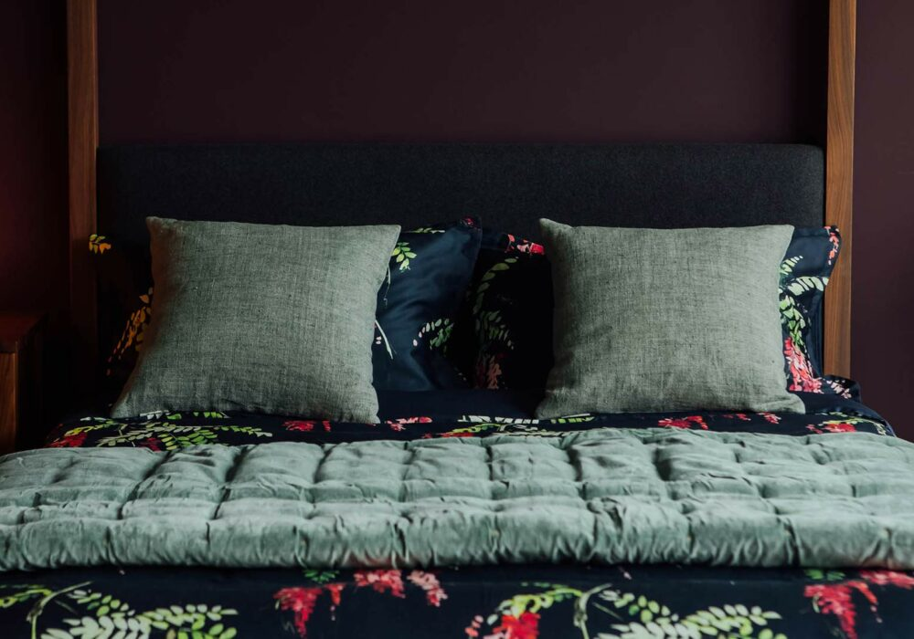 crimson-blossom-print-with-sage-green-velvet-quilt-and-cushions