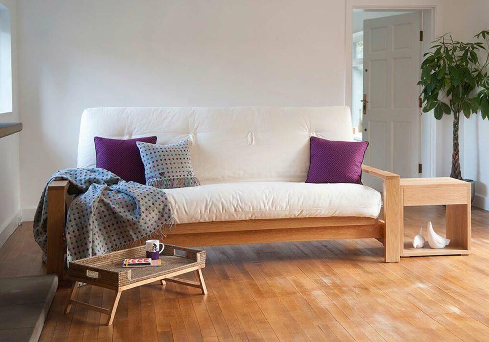Cuba Futon Sofa Bed shown as a sofa and in Oak
