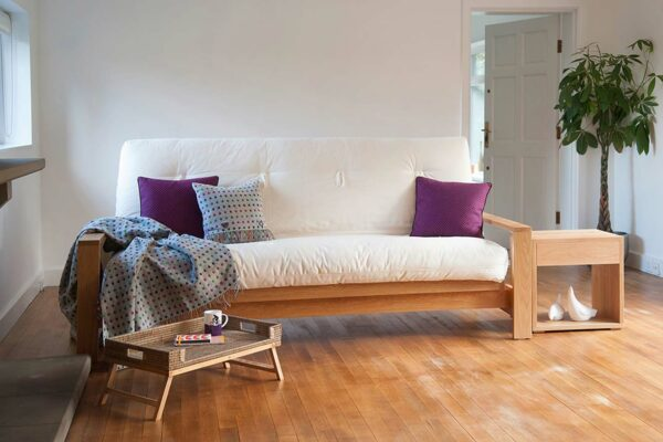 Cuba Futon Sofa Bed shown as a sofa and in Oak