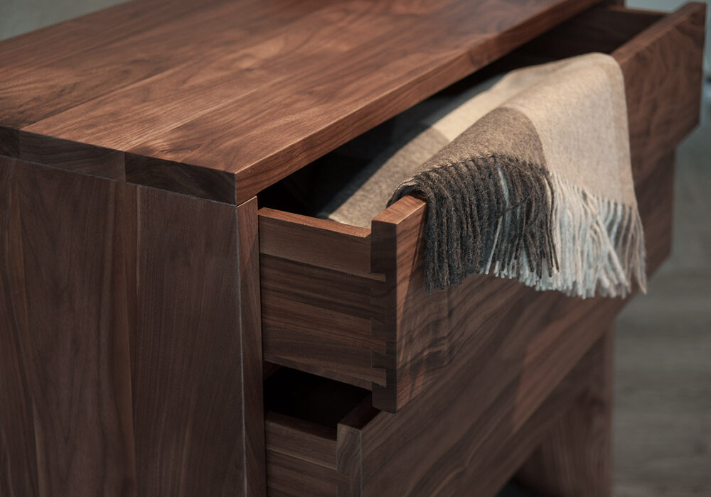A close up view of the drawers in our Walnut storage chest by Black Lotus.