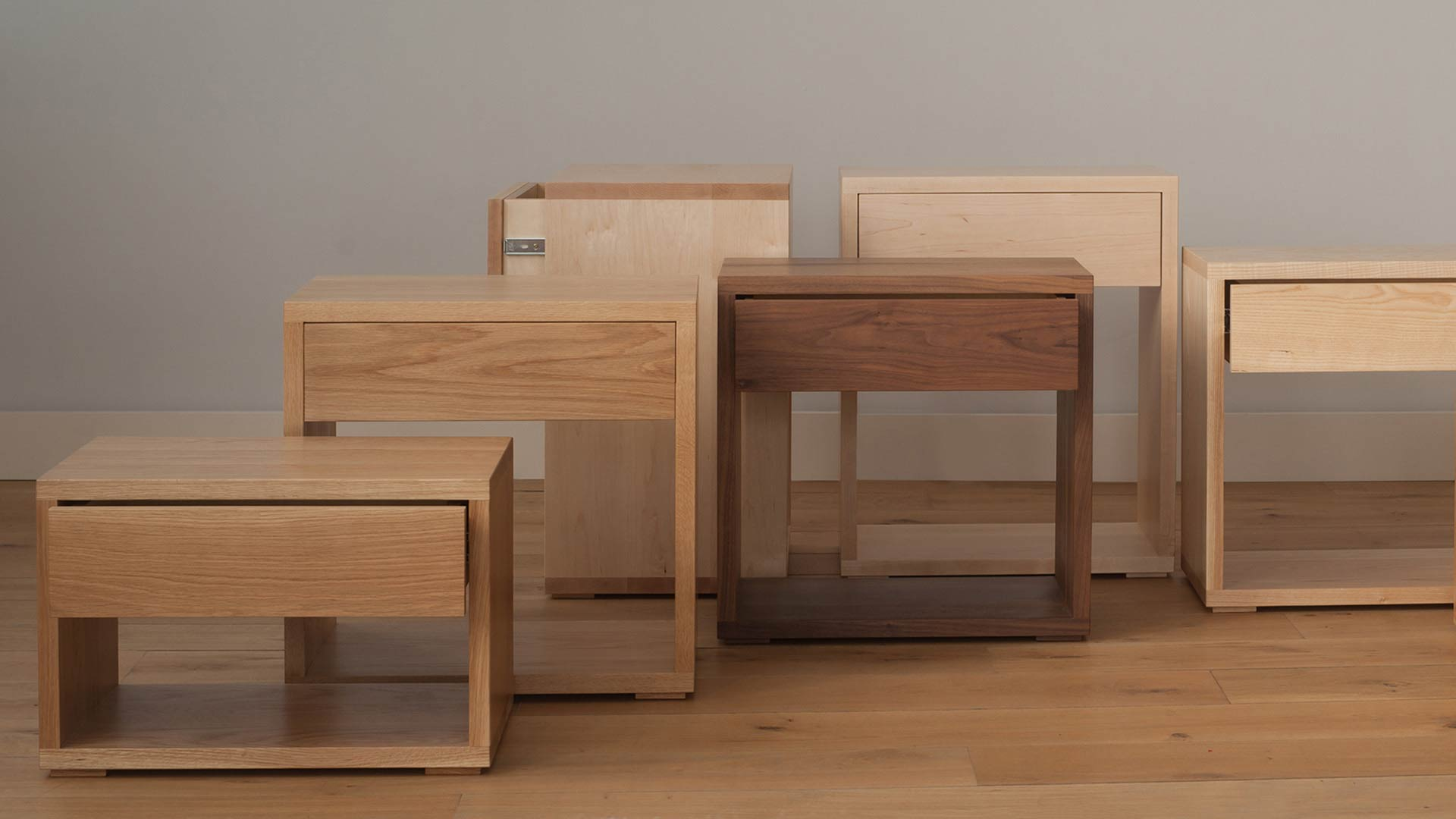 Hand crafted in Sheffield our Cube tables collection come in a range of wood choices to match your bed.