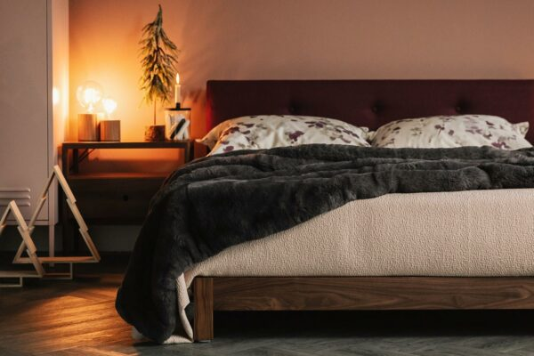 Christmas bedroom scene featuring our low Kingsize Iona bed with buttoned padded headboard.