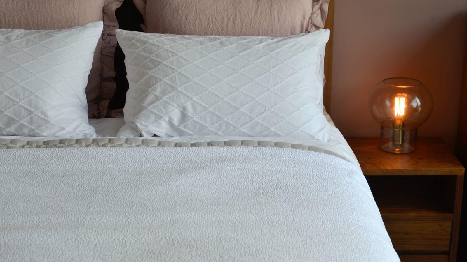 white textured bedspread