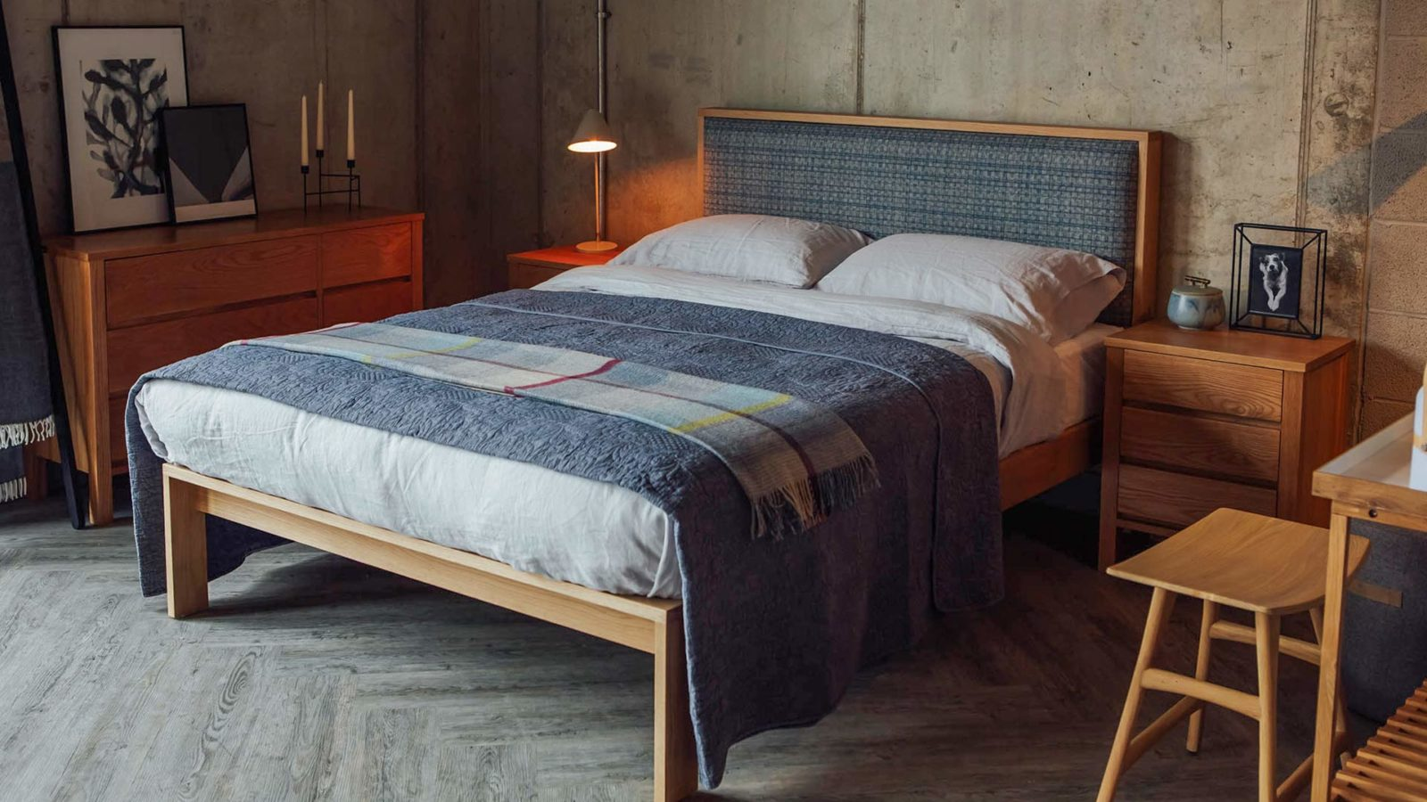 Blue quilted bedspread on Hand crafted wooden Shetland bed made in uk