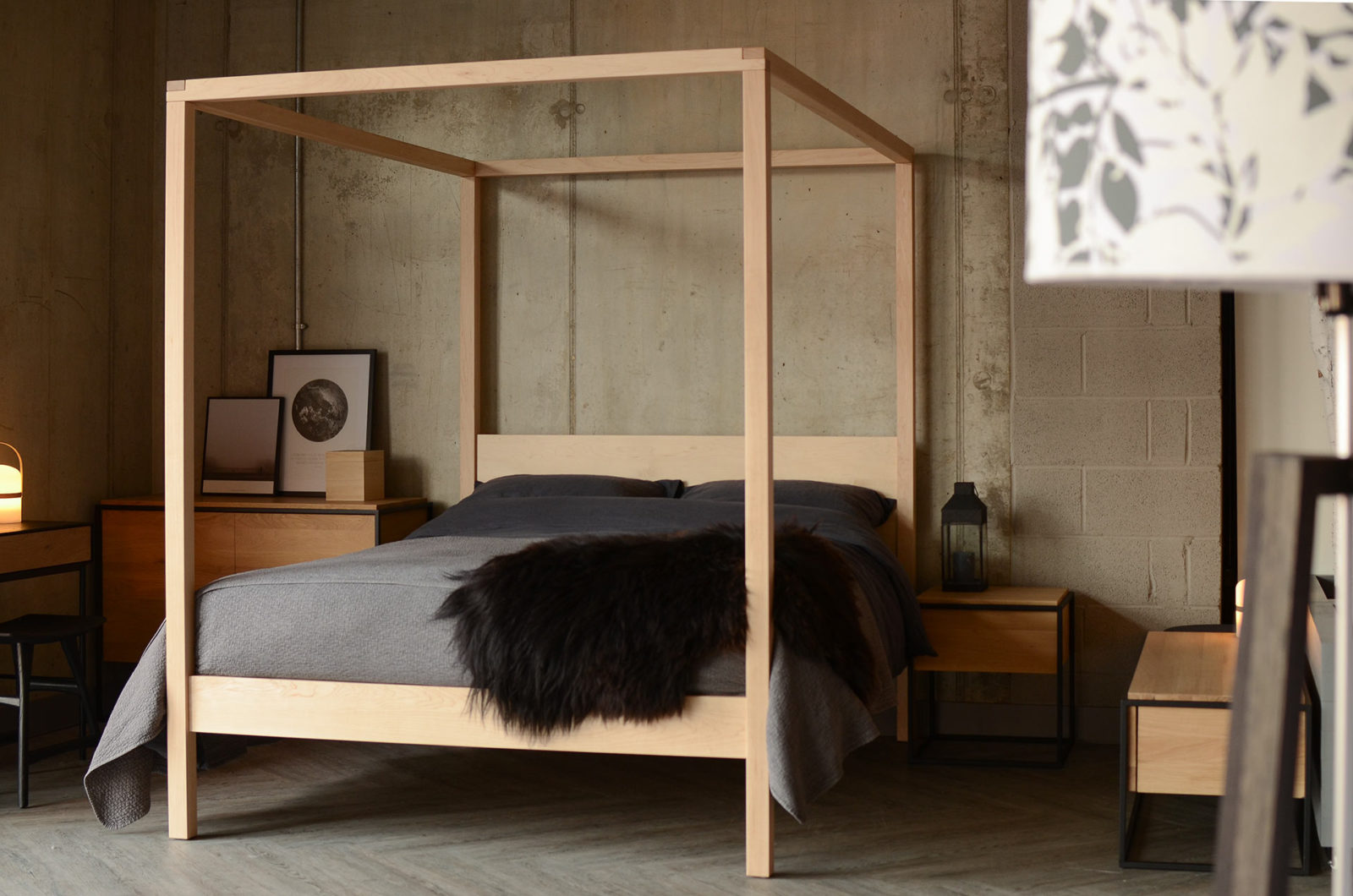 Dark bedding on a Maple Orchid 4 poster bed for a Nordic Bedroom look