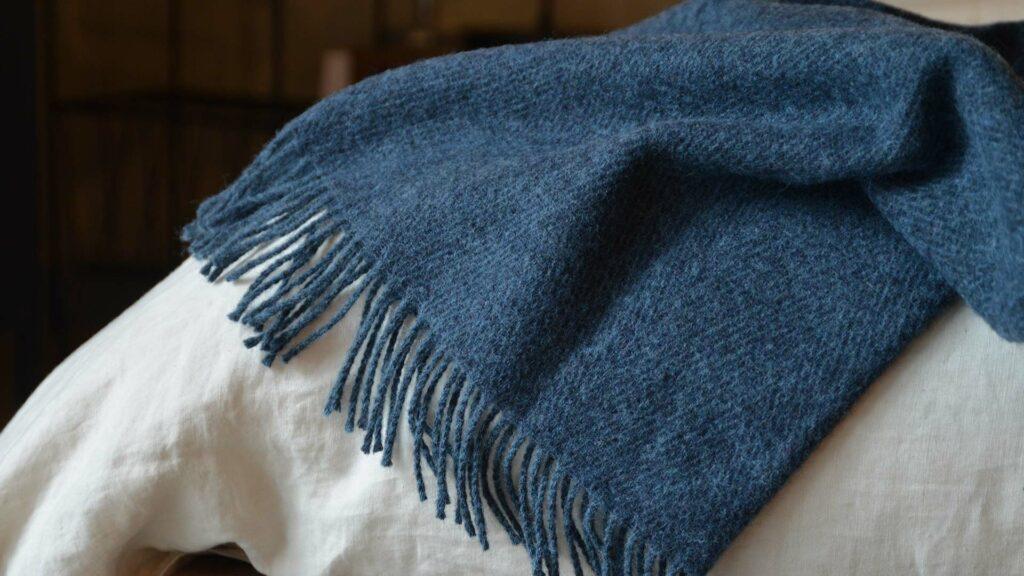 Denim blue herringbone weave pure wool throw with fringed edging