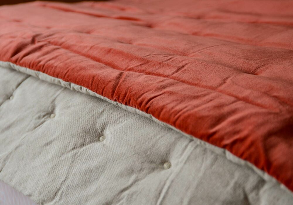 coral quilted throw