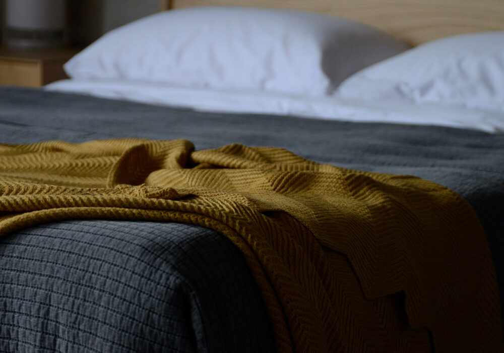 soft knitted textured throw in mustard