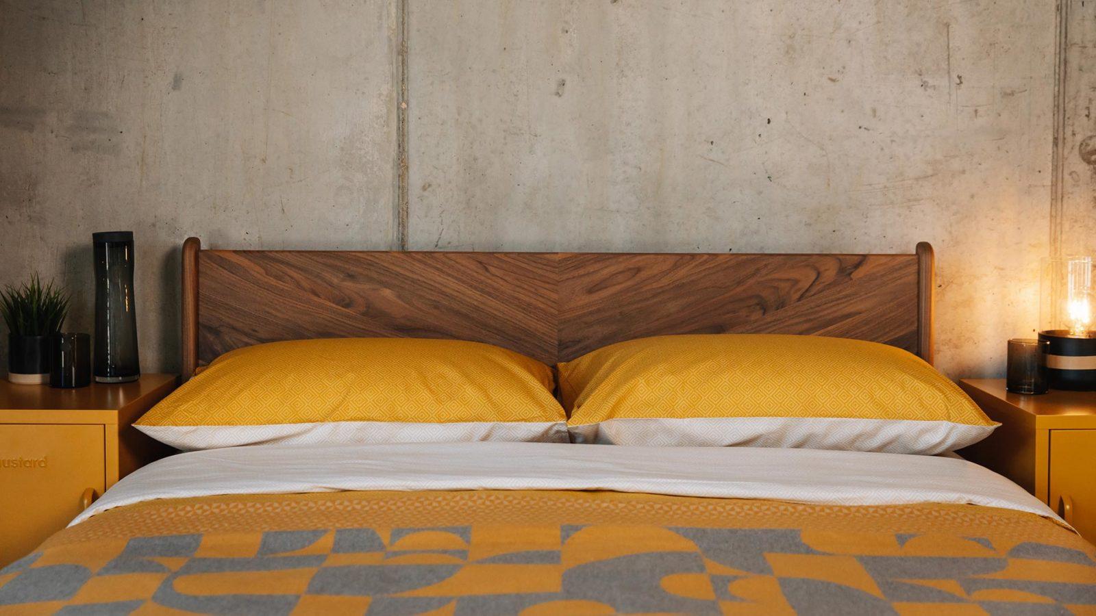 yolk yellow bedding against our chevron patterned walnut Hoxton headboard