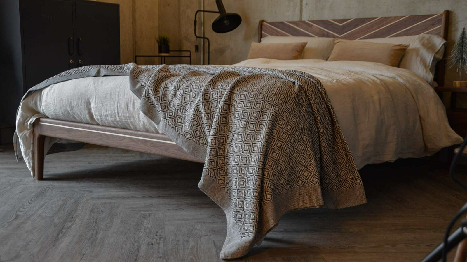 Cotton-rich woven black and white bedspread on our solid wooden special Hoxton bed
