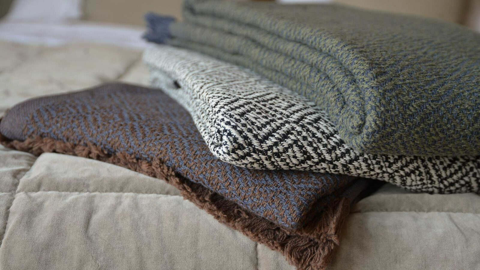 cotton rich woven diamond pattern throws in three colour options