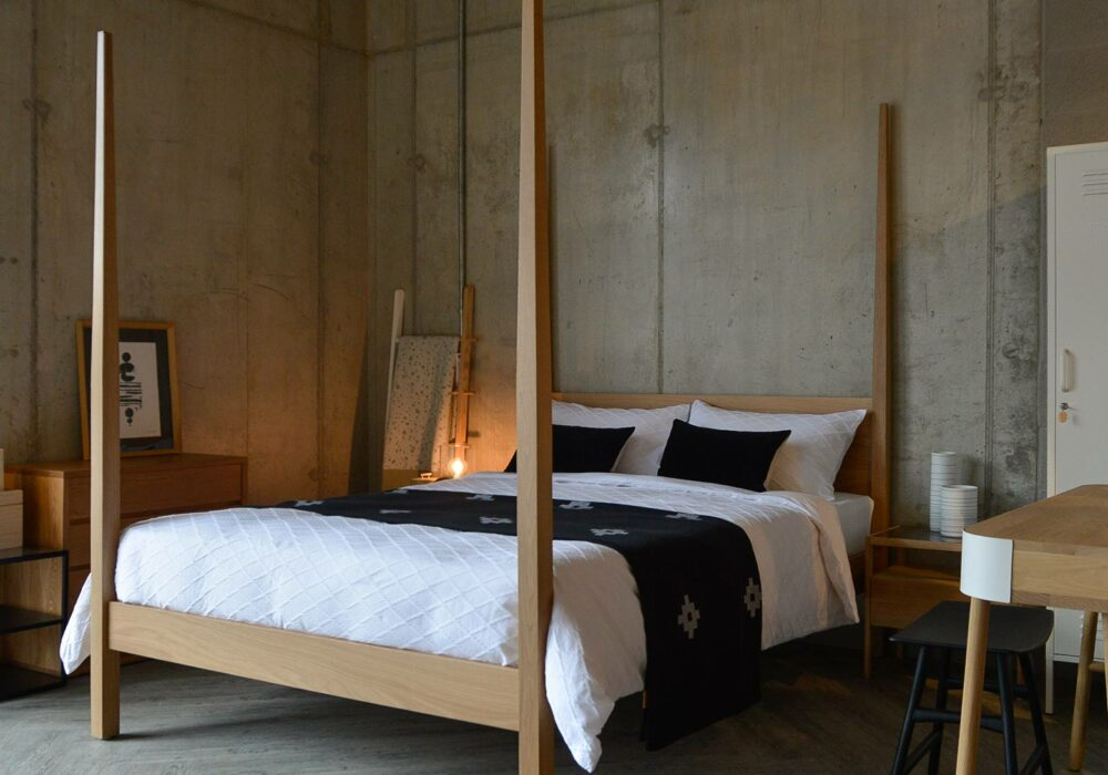 shown at an angle our 4 post Hatfield bed, a solid wood taller classic bed