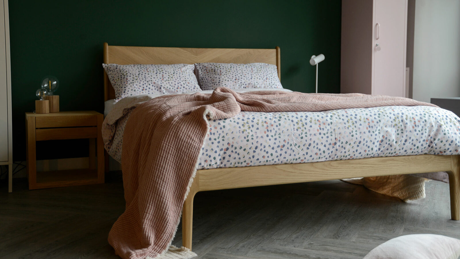 reversible cotton blend duvet cover set with pastel colours paint brush dots print and shown on oak Hoxton bed