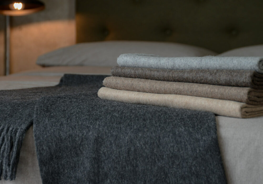 luxury recycled wool throws in a choice of neutral colours