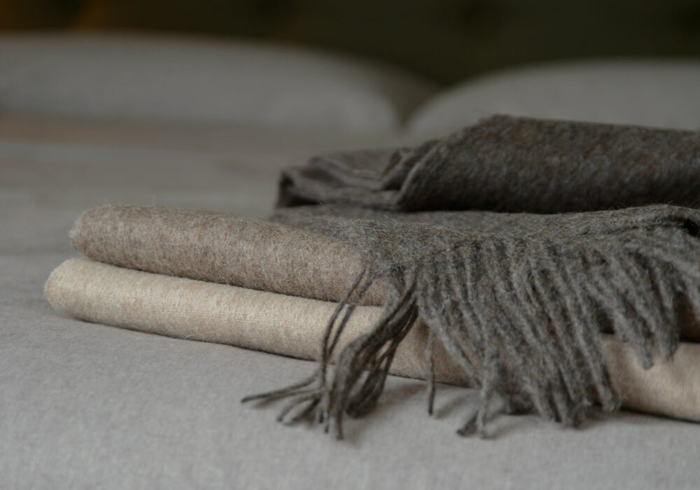 soft recycled wool fringed throws in a choice of brown marl colours