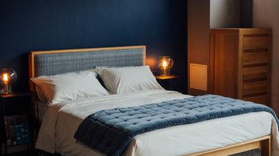 Blue patterened wool headboard on our wooden Shetland bed in Oak