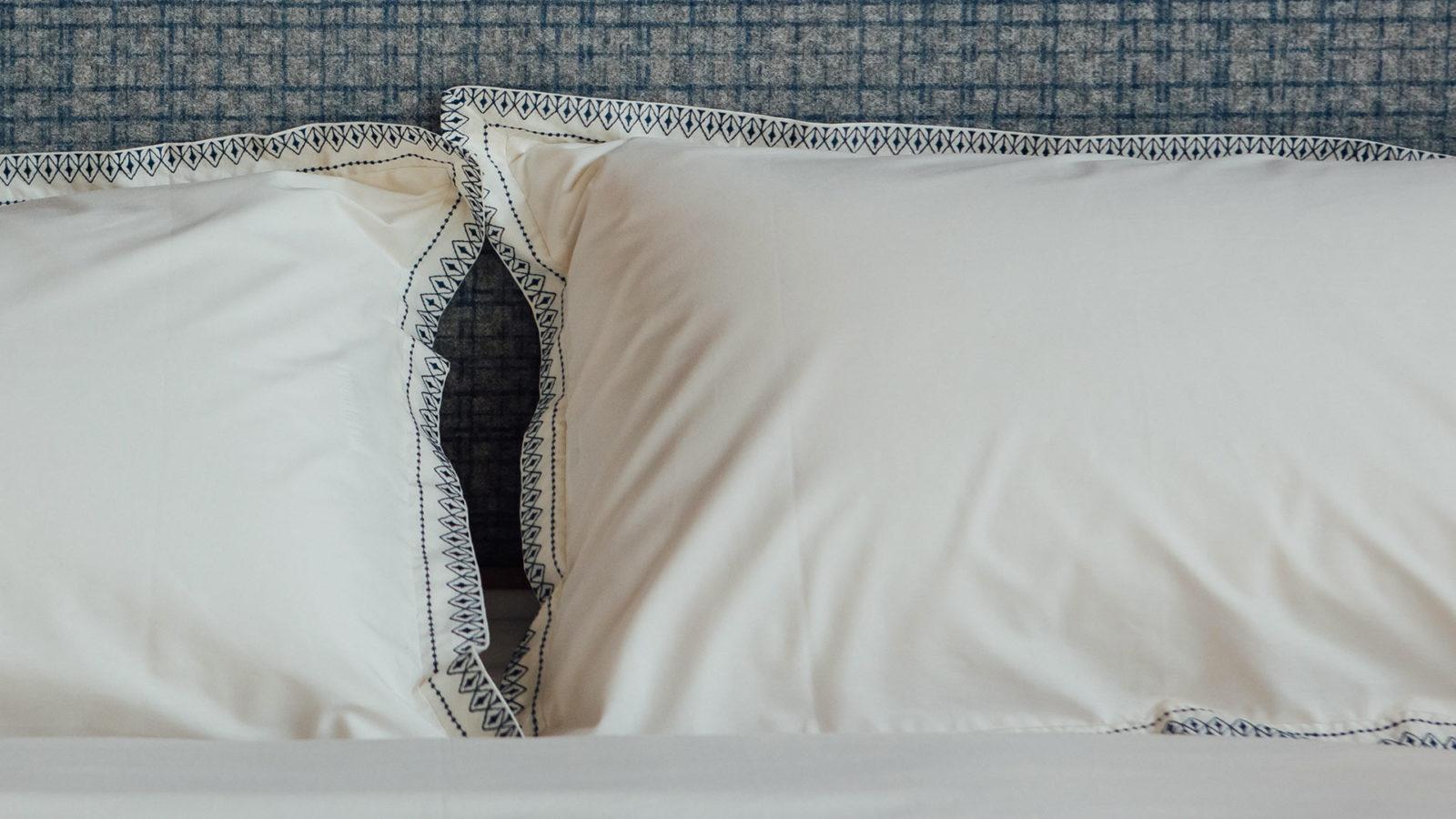 embroidered-duvet-set-navy-on-Shetland-bed