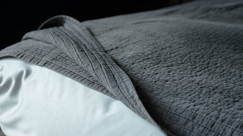 grey textured bedspread