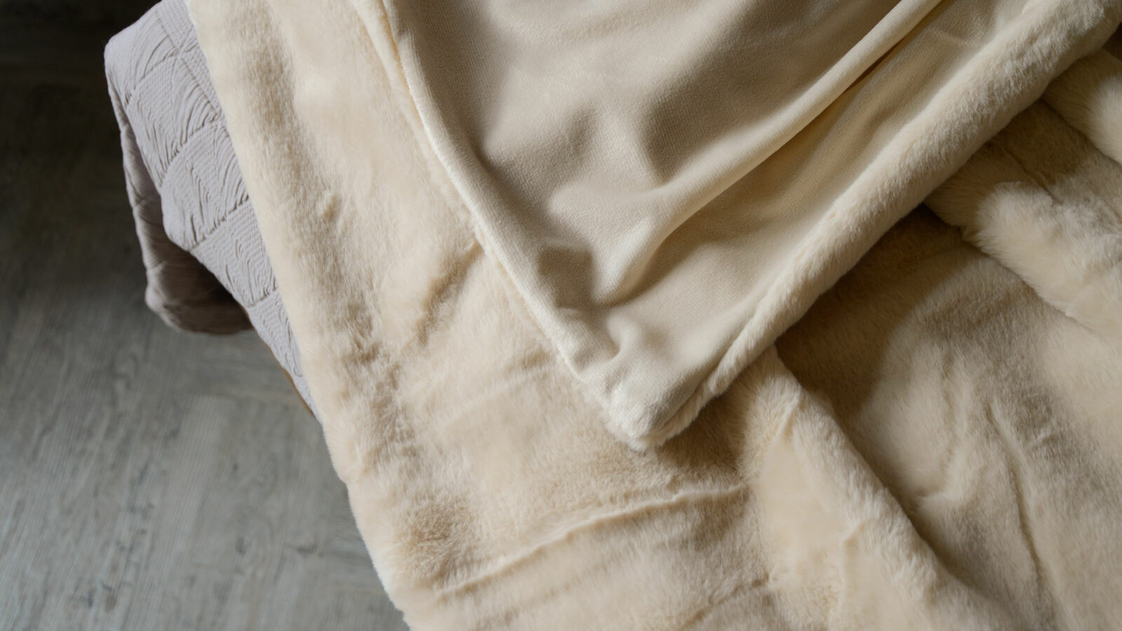 faux fur bedspread in nude colour showing velveteen reverse