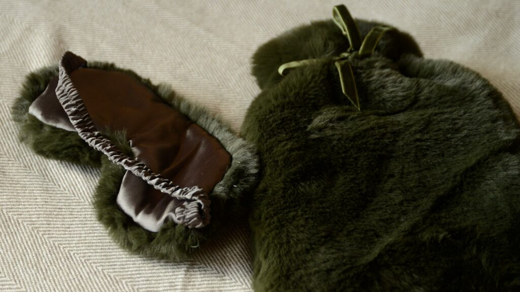 softest luxury faux fur hotwater bottle and eye mask set in olive green