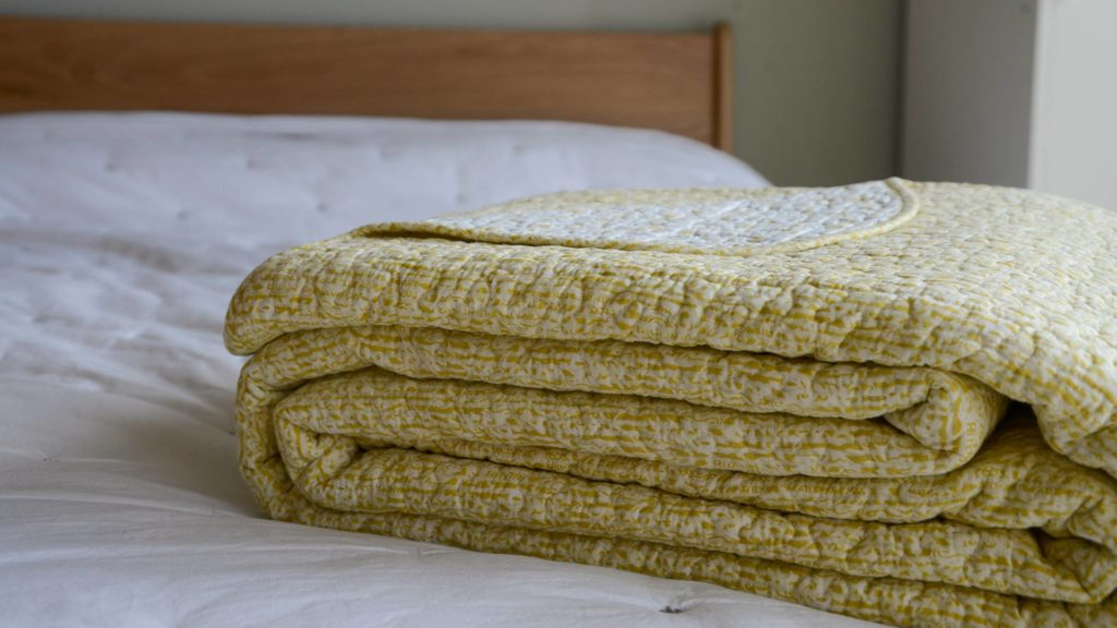 reversible bedspread in yellow and ivory