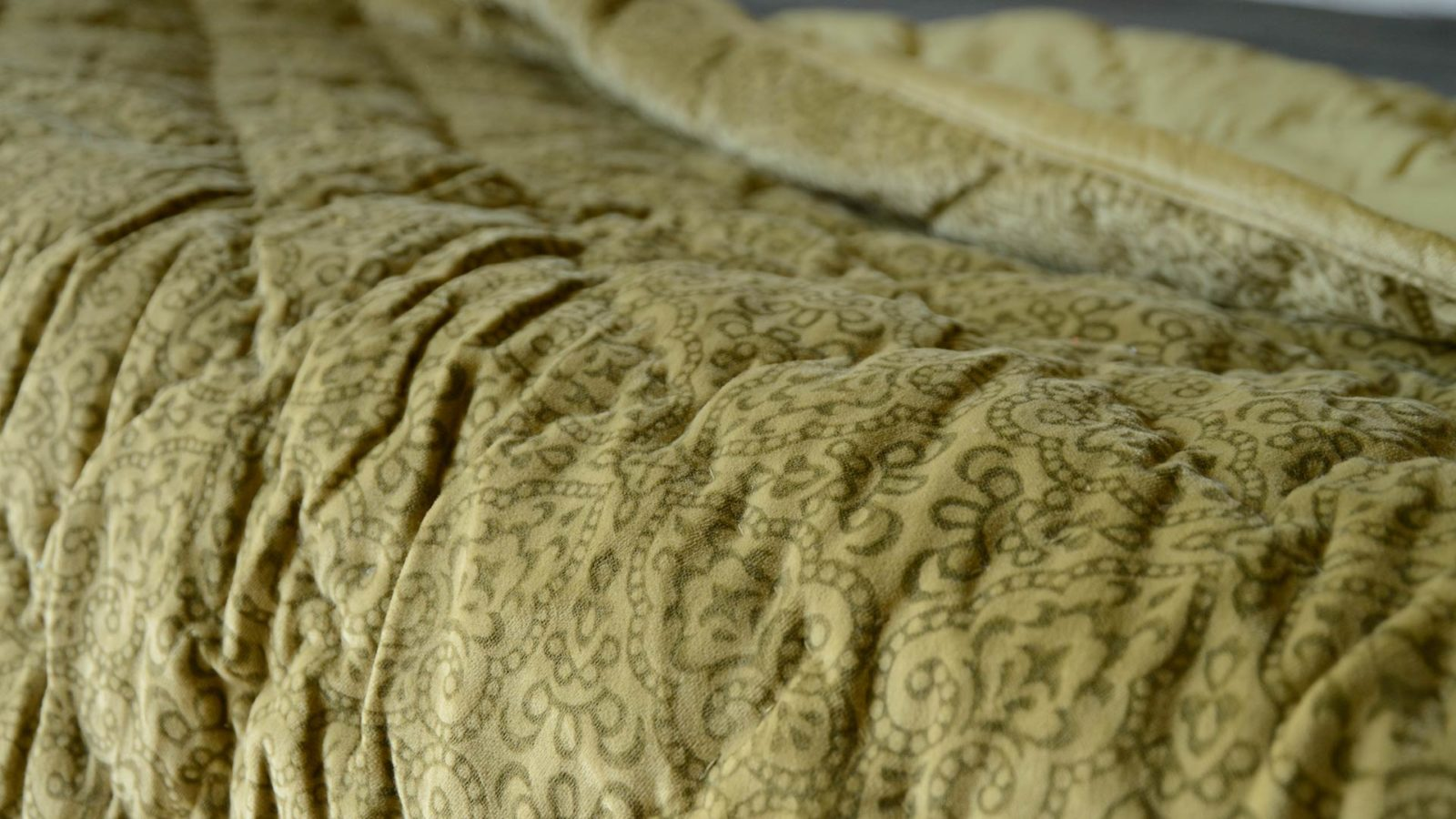 patterned velvet quilted throw