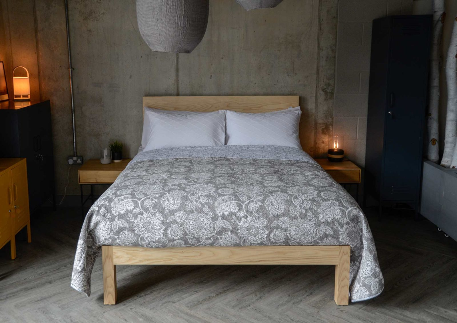grey and white floral print quilted bedspread