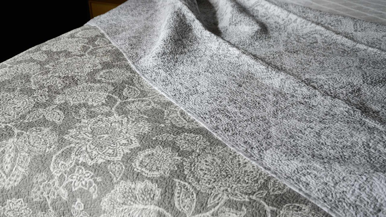 grey and white floral print reversible quilted bedspread