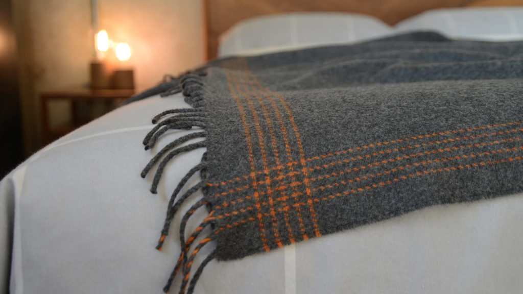grey-and-orange-striped-throw in merino and cashmere