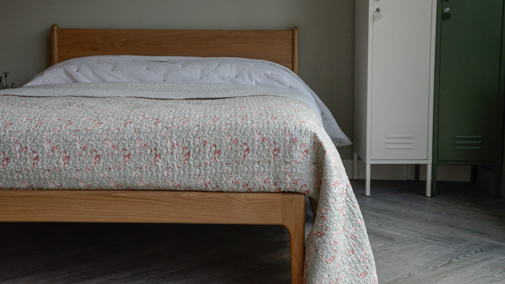 grey, vintage look reversible bedspread