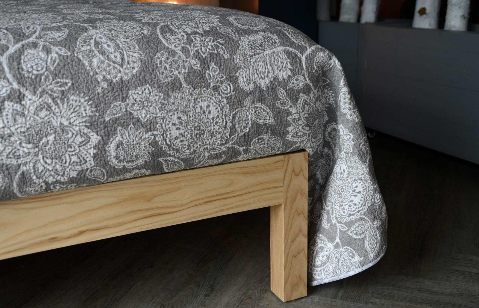 grey floral patterned reversible quilted bedspread