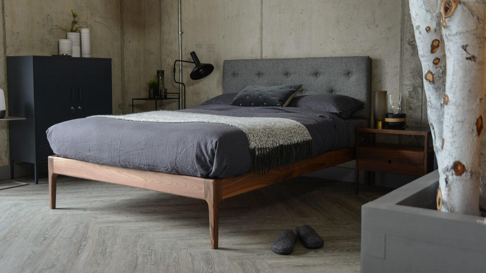 The Bloomsbury classic wooden bed with a solid walnut frame and buttoned upholstered headboard