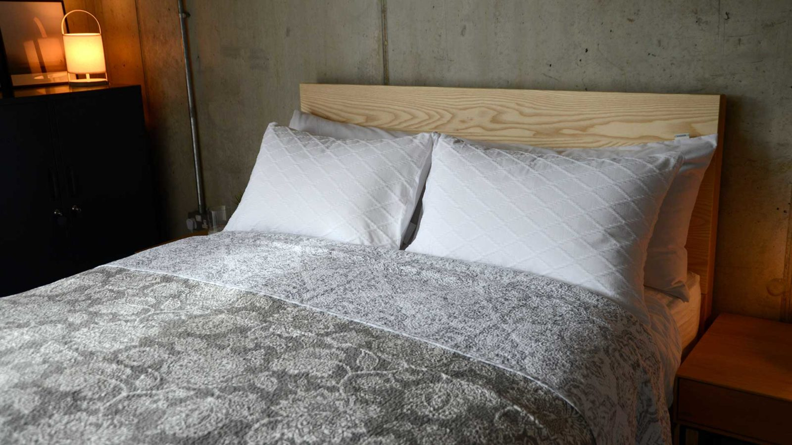 lightweight reversible quilted bedspread with grey floral design