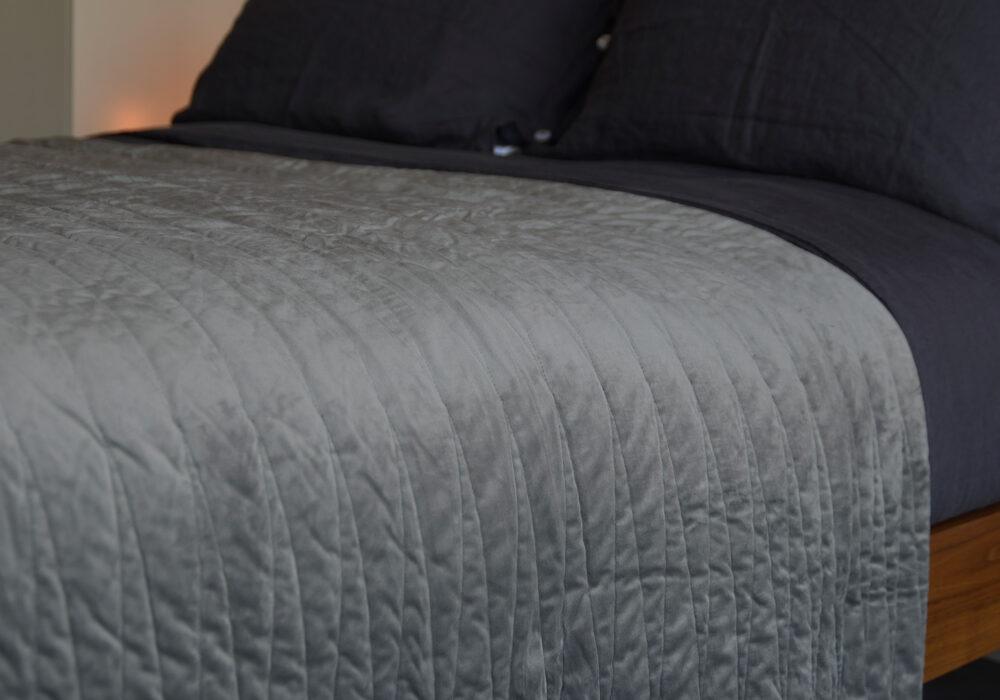 Grey velvet look harlequin bedspread