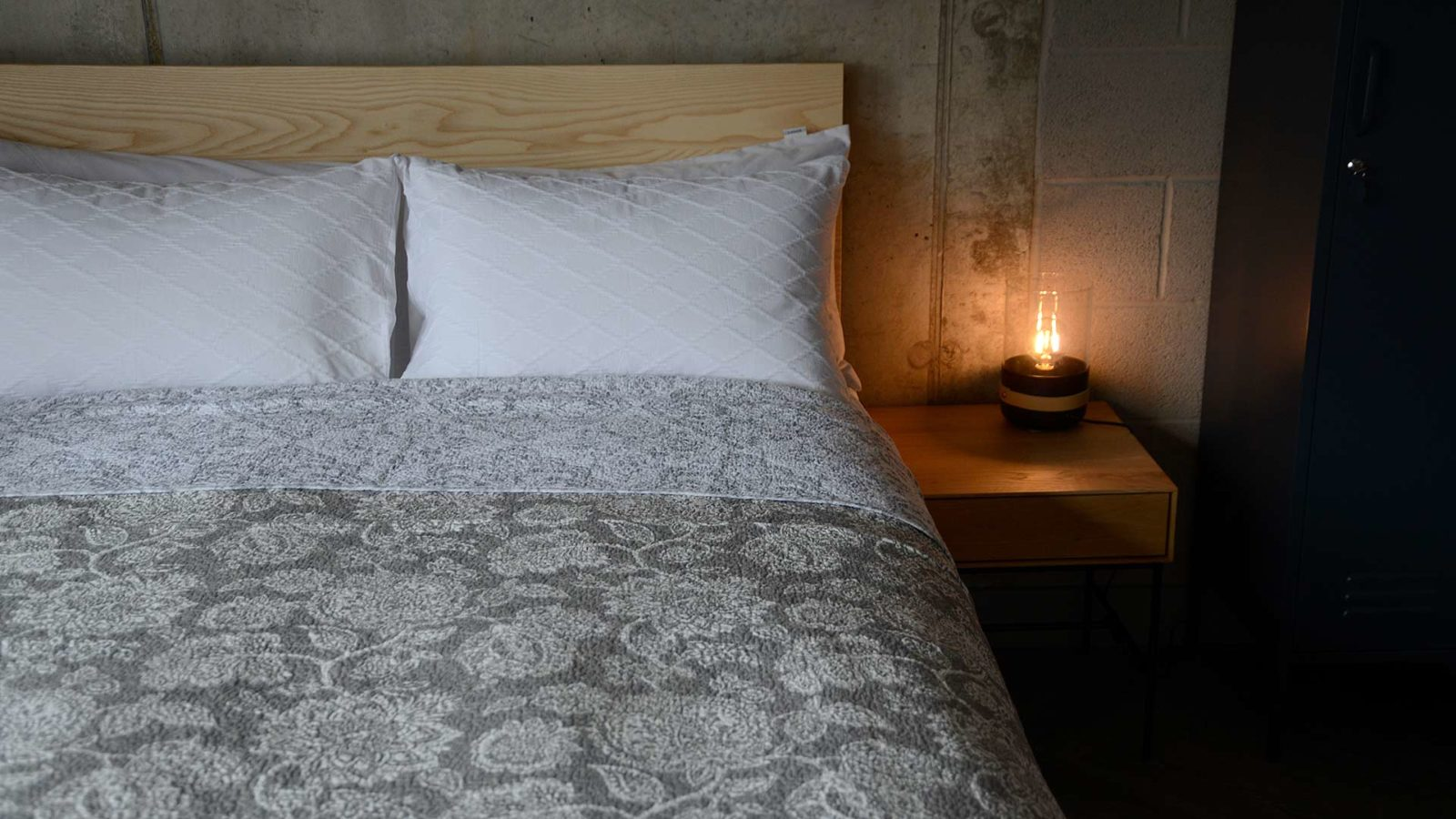 classic quilted bedspread with a grey and white floral pattern
