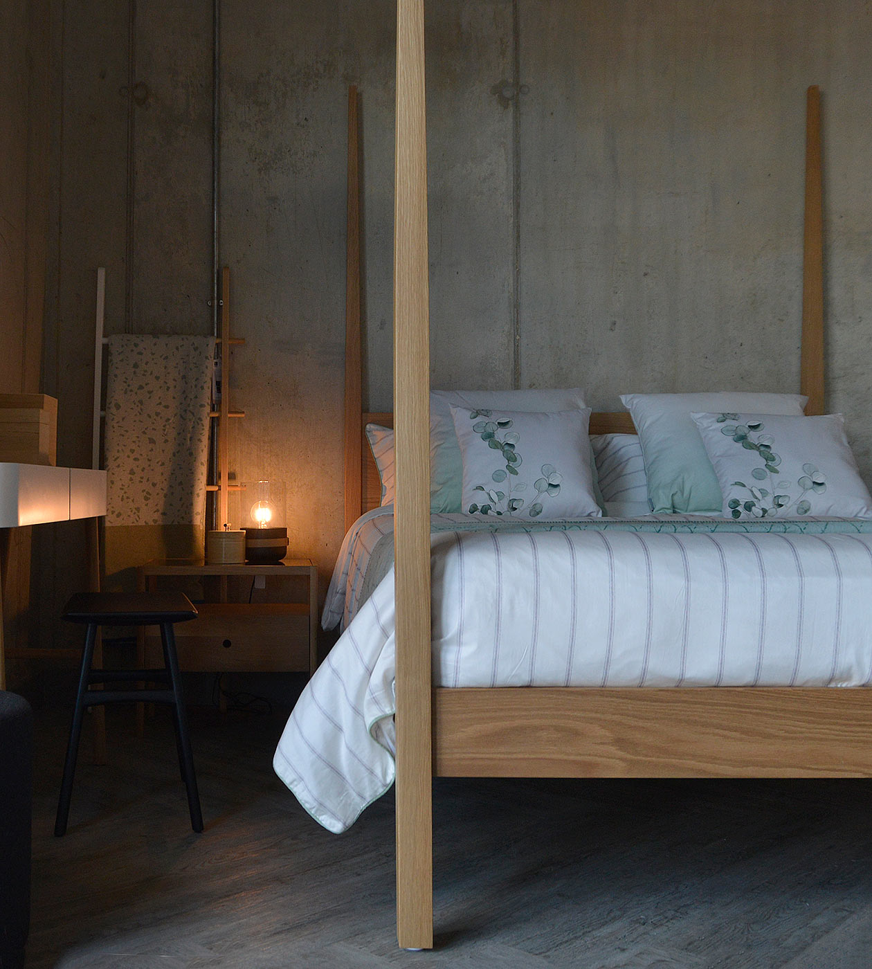 Hatfield is a taller wooden bed with 4 tall posts. Here shown in Oak