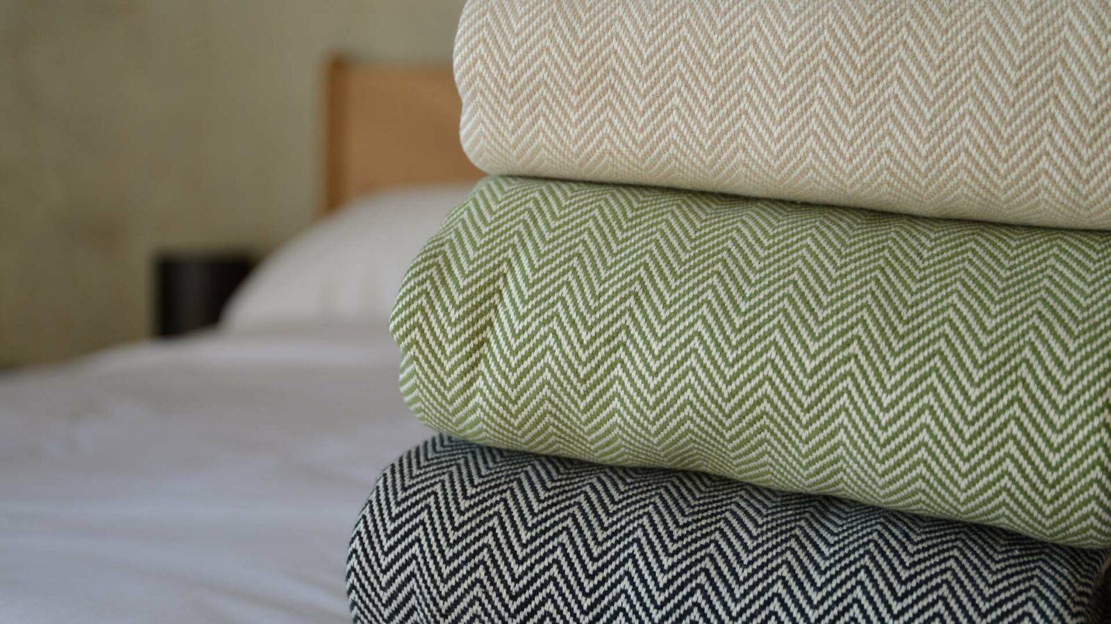 Hand woven cotton blankets with two colour herringbone weave in 3 colour choices