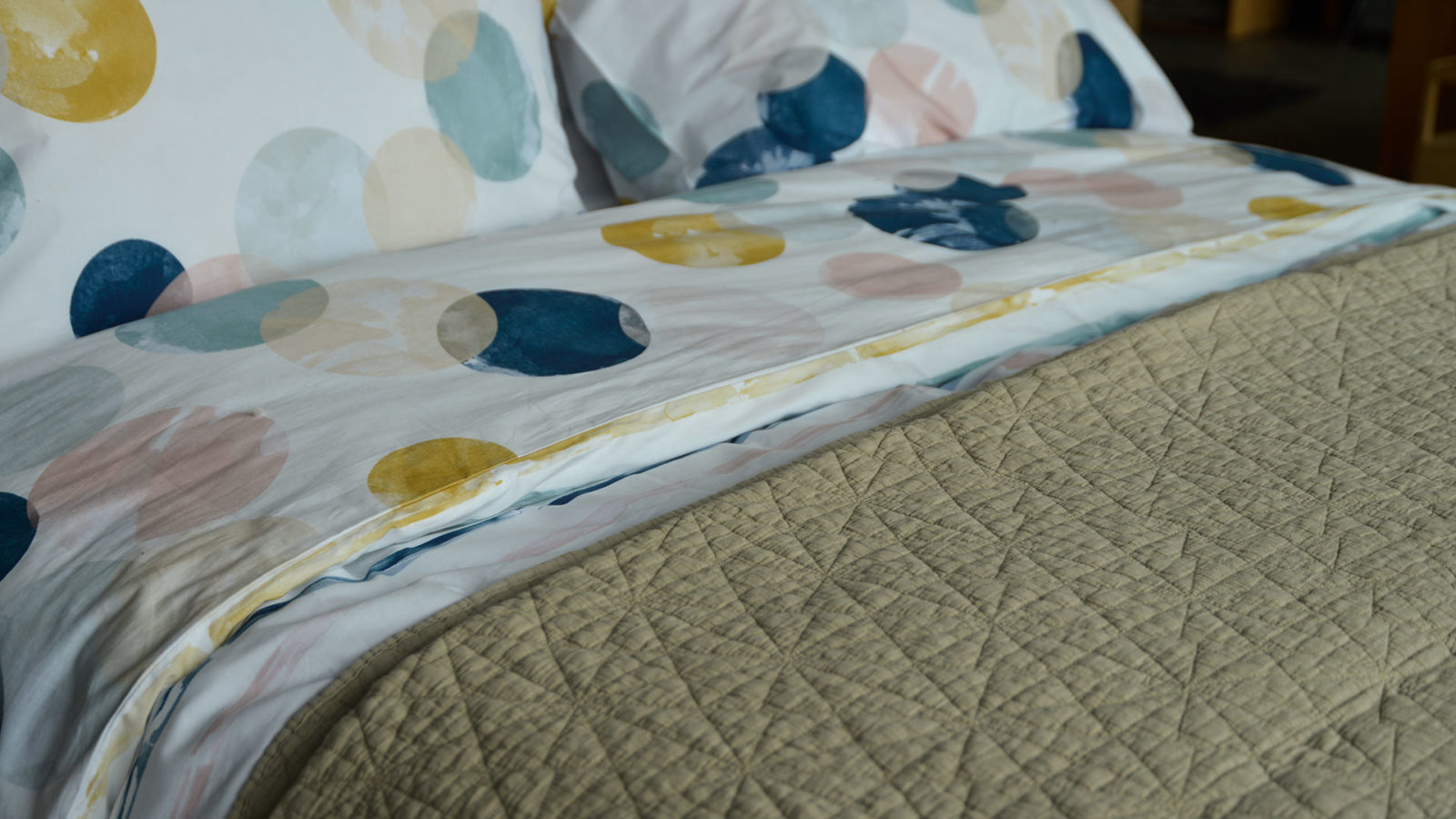 limestone colour embroidered quilt