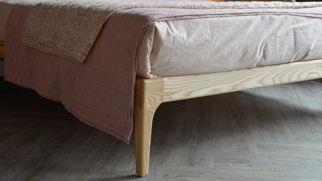 A closer view of the wooden Hoxton Bed leg made from Ash wood.